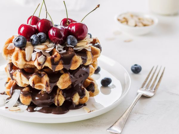 Waffles with berries and chocolate sauce